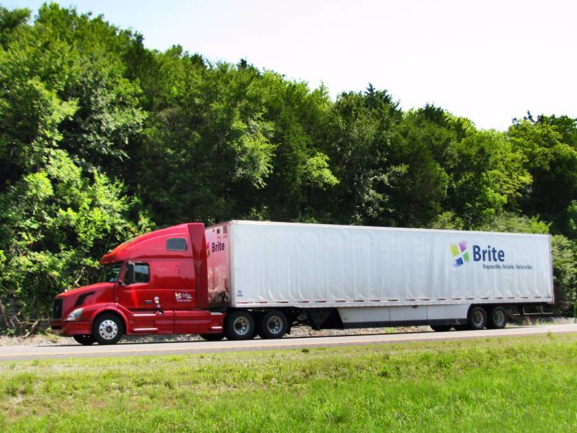brite logistics chicago trucking company asset-based carrier red truck on the road